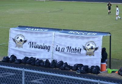 2 large vinyl banners cover soccer team benches.