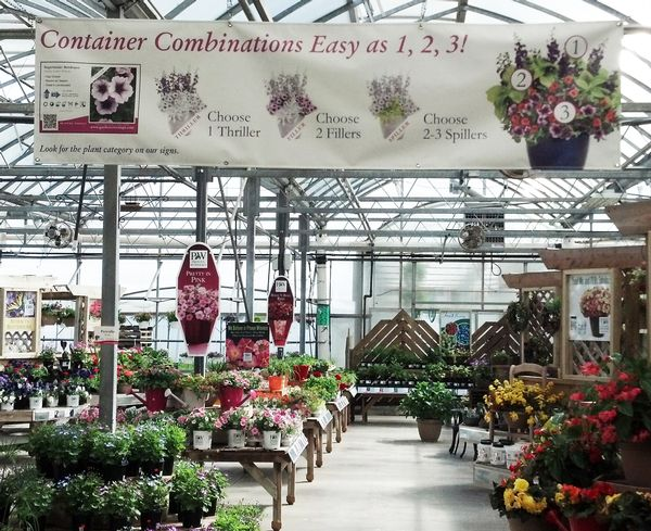 This 8' x 2' custom banner helps sell plants for container combinations and ties directly to their plant bench cards. Relevant plants are identified as either a 'Thriller', 'Spiller', or 'Filler' on the bench card.